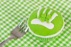Cupcake St. patricks day. Green cupcake for St. Patricks day with fork Royalty Free Stock Image