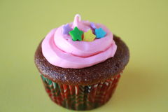 Cupcake with stars and pink frosting Stock Images