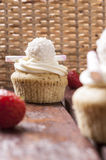 Cupcake with strawberries and cream. Jam cupcake with mascarpone cream cheese topping strawberry on table in studio Stock Images