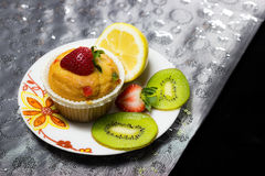 Cupcake with strawberry topping Royalty Free Stock Images