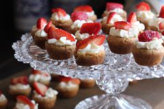 Cupcake With Strawberry Toppings on Clear Glass Cup Cake Rack Stock Photography