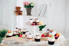 Cupcake on table lifestyle photo. A cupcake on a table lifestyle photo  interior Stock Images