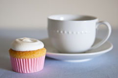 Cupcake and tea cup Stock Image