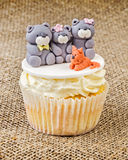 Cupcake with teddy bear family on rustic jute background Royalty Free Stock Photos