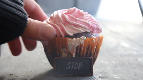 Cupcake, and text Stop - unhealthy food or diet idea stock video