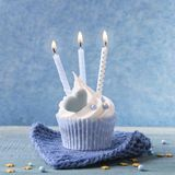 Cupcake with three candles. Cupcake with three blue candles Royalty Free Stock Photography