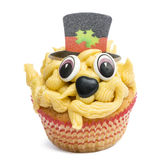 Cupcake with top hat decoration against white background Royalty Free Stock Photo