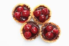 Cupcake topped with chocolate cream and cherries aga Stock Photo