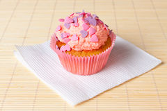 Cupcake with topping in the form of hearts Royalty Free Stock Images