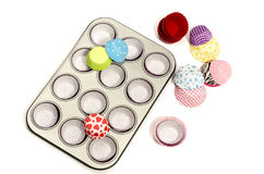 Cupcake tray with all colors paper and silicone liners. Royalty Free Stock Photo