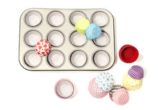 Cupcake tray with all colors paper and silicone liners. Stock Image
