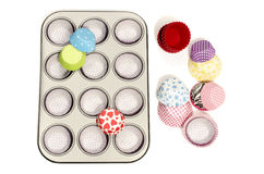Cupcake tray with all colors paper and silicone liners. Stock Images