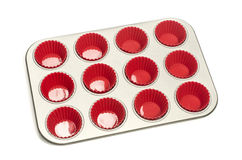 Cupcake tray with red silicone liners. Stock Image