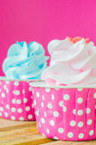 Cupcake. Two Cupcake on color background Royalty Free Stock Images