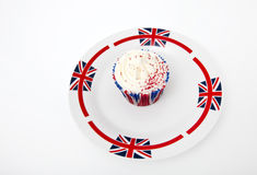 Cupcake in Union Jack plate against white background Royalty Free Stock Photography