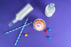 Cupcake for Valentine's Day with hearts on top of whipped cream and milk cocktails with retro cocktail tubes, served in bottles on Royalty Free Stock Photos