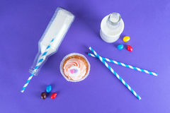 Cupcake for Valentine's Day with hearts on top of whipped cream and milk cocktails with retro cocktail tubes, served in bottles on Stock Photography