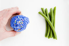 Cupcake or vegetables Stock Image