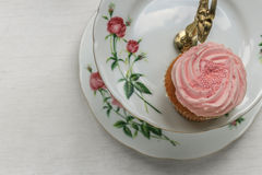 Cupcake on a vintage cake stand. Stock Photo