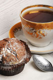 Cupcake with vintage tea cup Stock Images