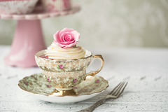 Cupcake in a vintage teacup Royalty Free Stock Images