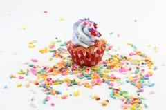 Cupcake. Violet blue  Cream Cupcake on sugar sprinkle Stock Photo
