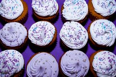 WALLPAPER OF DELICIOUS CUPCAKES DECORATED WITH SPARKS stock image