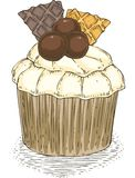 Cupcake with Wawwles and Chocolate Balls Stock Photography