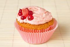 Cupcake with whipped cream and redcurrant Stock Image