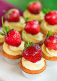 Cupcake with whipped cream and strawberry Royalty Free Stock Photos