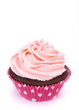 Cupcake on White. A chocolate cupcake with pink icing on a white background. Copy space royalty free stock photos