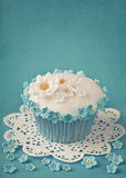 Cupcake with white and blue flowers Stock Photo