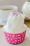Cupcake. White cream Cupcake on wood table Royalty Free Stock Image
