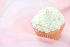 Cupcake with white frosting Royalty Free Stock Photos