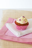 Cupcake with white icing Stock Images