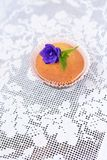 Cupcake on a white lace tablecloth Stock Images