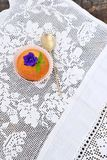 Cupcake on a white lace tablecloth Royalty Free Stock Image