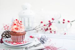 Cupcake with white and red cream Royalty Free Stock Photos