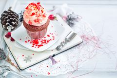 Cupcake with white and red cream Royalty Free Stock Images
