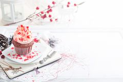 Cupcake with white and red cream Stock Image