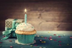 Free Cupcake With Birthday Candle Stock Photography - 76932082