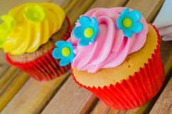 Cupcake. On the wood table Royalty Free Stock Images