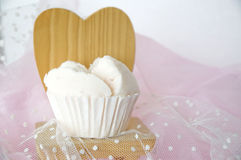 Cupcake on wooden chair Stock Images
