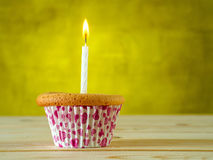 Cupcake on wooden table Royalty Free Stock Images