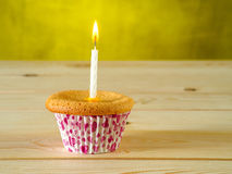 Cupcake on wooden table Royalty Free Stock Image