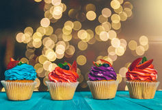 Cupcake on wooden table on light background. Cupcake on table on light background Stock Images