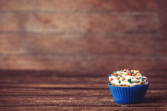 Cupcake on wooden table. Royalty Free Stock Photo