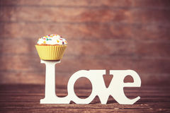 Cupcake and word Love Stock Images