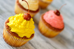 Cupcake with yellow icing. Stock Photo