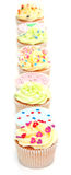 Cupcakes. Some delicious home made cup cakes on white Stock Image